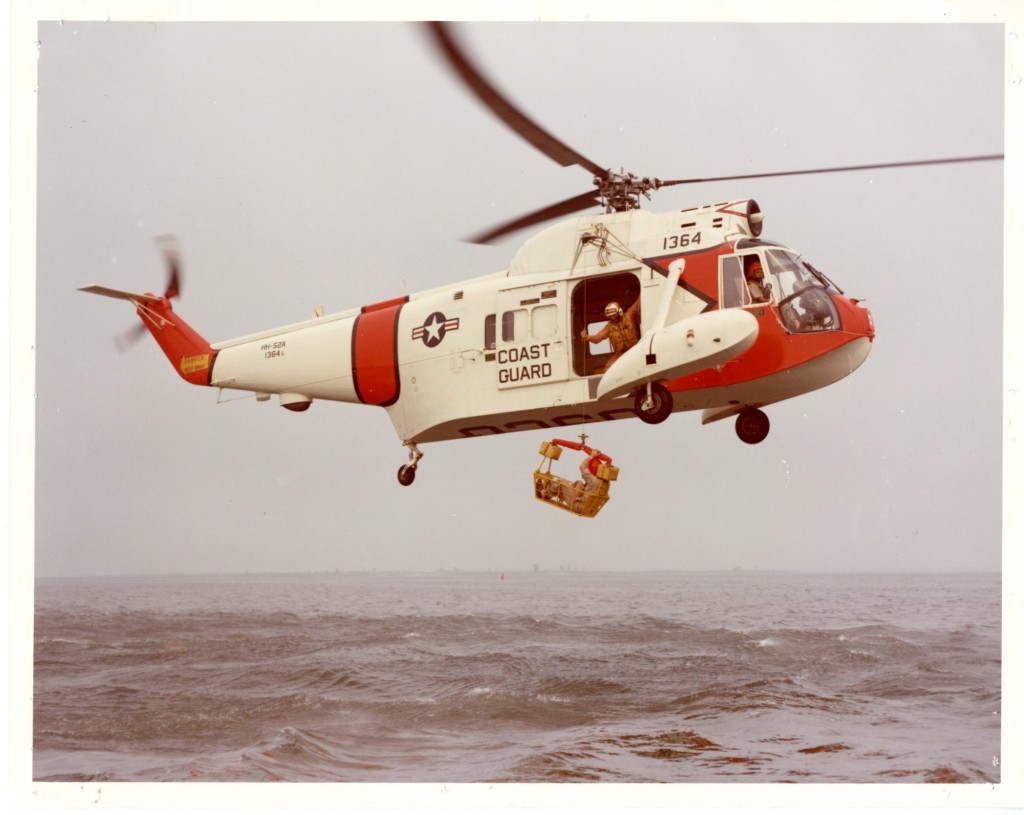 photo of USCG helicopter over water